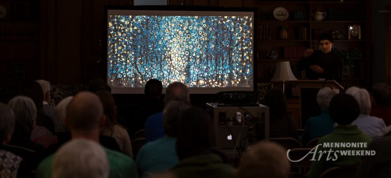 Slide presentation by Randall Stoltzfus to audience in darkened room. Image on screen is of blue and gold painting titled 'thicket'