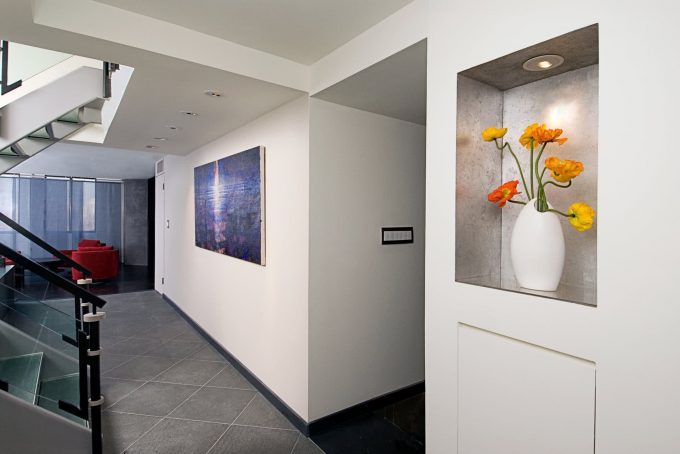 """Installation view showing the painting """"Slip"""" by Randall Stoltzfus ihanging in the entry of a Manhattan penthouse apartment"""