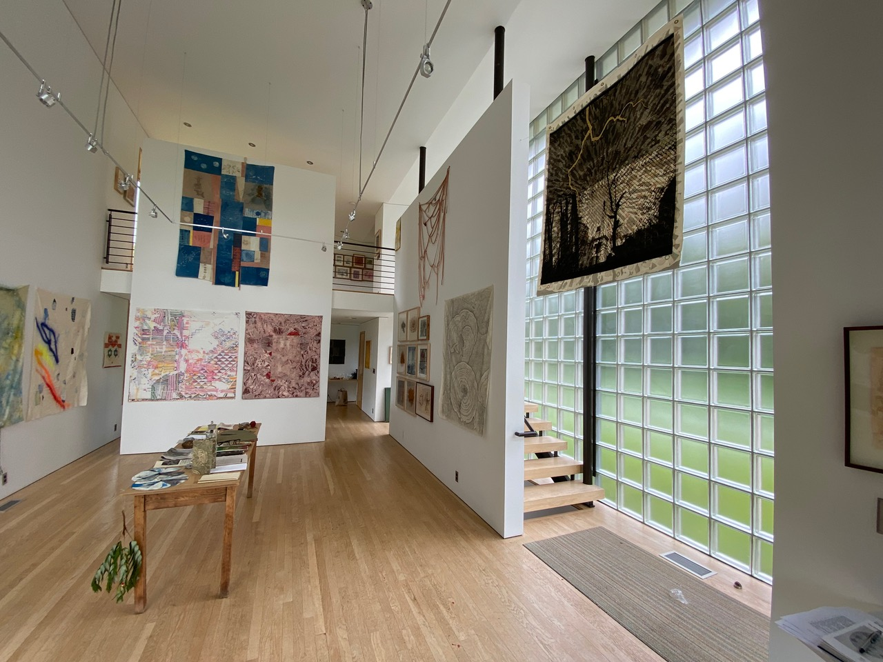 Artwork by members of The Printmakers Left installed at Les Yeux Du Monde Gallery in Charlottesville, VA